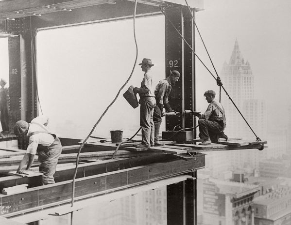 29 Sep 1930 --- Original caption: Flirting with danger is just routine work for the steel workers arranging the steel frame for the Empire State Building, which will be the world's tallest structure when completed. Erected on the site of the old Waldorf Astoria, this building will rise 1,284 feet into the air. A zeppelin mooring mast will cap this engineering feat. --- Image by © Bettmann/CORBIS